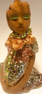 "JoAnne stands 8"" x 6"" x 5"" and weighs 1.9 ozs. JoAnne has a honey brown complexion with clay corn rolled hair. She wears an alligator green  copper metallic dress. JoAnne wears an awesome copper spiral and  beaded necklace. Janet has her long loving arms at her side as she rest and waits."