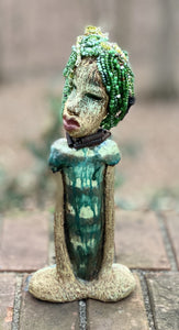 "Norway has fifty shades of green in her complexion! She stands 12"" x 5"" x 3"" and weighs 2.3 lbs. Norway has over 100 very small 6mm hand strung beads in her hair. Her look says it all. No way can you not love Norway!"