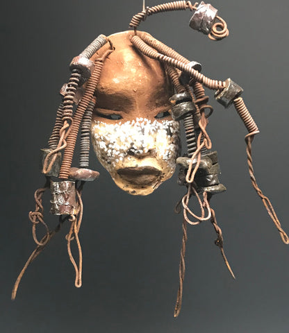 "Sonya has a light and dark honey brown complexion with white tribal markings.     Her  hair can be adjusted up to  11"" x 10"" and weighs 12 ounces!     Sonya has 15 handmade raku fired beads.     She has over 20 feet of coiled 16 gauge wire hair.  Sonya is ready for display!"