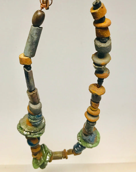 "Simple and Beautiful!      27"" lenght     Raku fired multicolored round and discs beads     small acrylic  and wood beads     7 ozs     Tribal  Shipping and Returns"