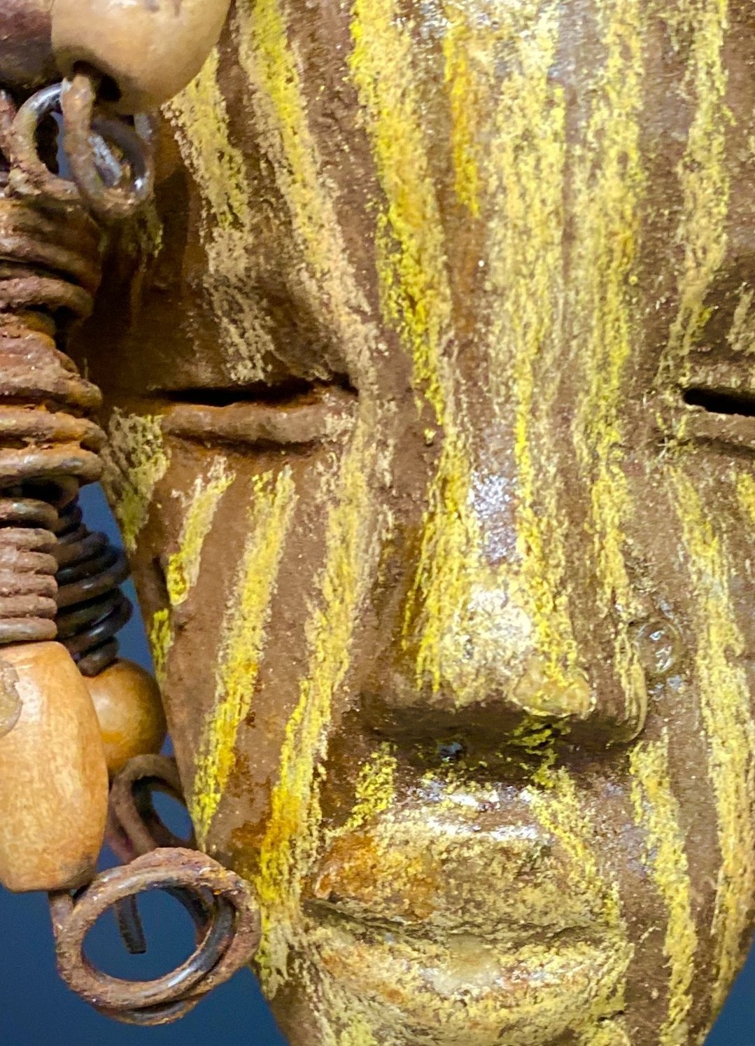 "I started making art soon after seeing authentic African artwork at the Smithsonian Museum of African Art. I was in total awe.  Kaba was inspired by my visit there.   Kaba has a two tone  striped complexion of earthy gold and brown. He is 5"" x 7"" and weighs 1 lbs. Kaba has over 10 wooden beads. He has over 10 feet of coiled 16 gauge wire hair. If for some reason Kaba does not fit in your home, send him back for a full refund!"
