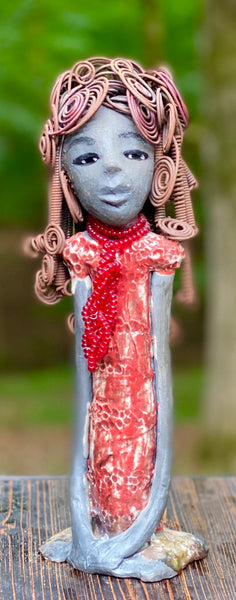 "Meet Reagan! Reagan stands 12"" x 4"" x 4"" and weighs 2.10 lbs. Reagan has a lovely dark complexion. It took over two hours to fix her Herdew! It is made of 16 gauge wire. Reagan has a shimmering  metallic copper red dress. A strand of ruby red beads hangs around her neck. Reagan and her sister Carolyn are one of a kind. ( Sold Separately) Give Reagan and Carolyn a great Home!"