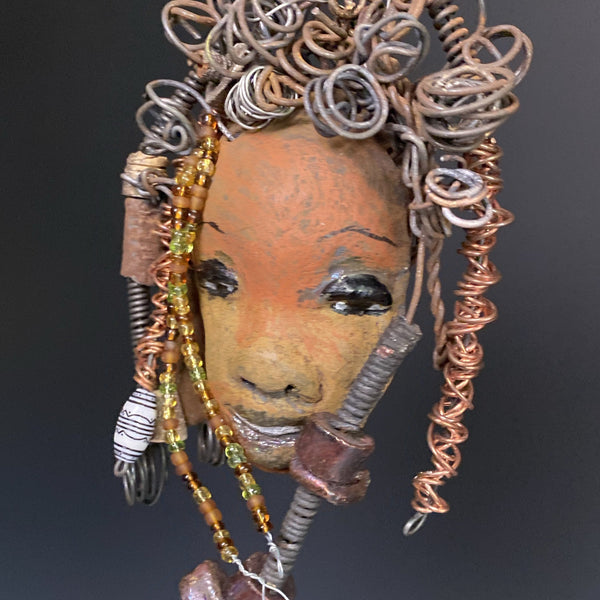 "I started making art soon after seeing authentic African artwork at the Smithsonian Museum of African Art. I was in total awe.  Layla was inspired by my visit there.  Layla  is 8""x 6"" and weighs 13 ozs. She has a two tone earthy honey gold complexion. Layla has  over 10 raku beads and over 50 mini colored and white beads  spiral coils of copper hair. She more than 10 feet of 16 gauge wire hair"