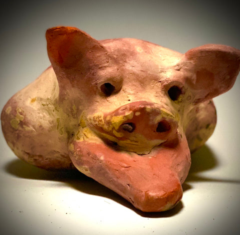 "This Little Piggy named Mike is 4"" x 5' x 6"" and weighs 1.8 lbs. Mike has a matte and satin pinkish complexion. Mike little curly tail is made of wire."