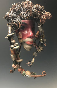 "Cayanne has a hot pink complexion and ruby red lips!     She is 5""x 7"" and weighs 12 ozs.     Cayanne  has over 30 handmade raku fired beads.     She has over 20 feet of coiled 16 gauge wire hair."