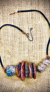 "Simple and Beautiful! (7) metallic multi size /colored raku bead, (2 )  spiral wire beads. 7""  hang brown suede cord Amazingly Lightweight! 3.6 ozs!!"