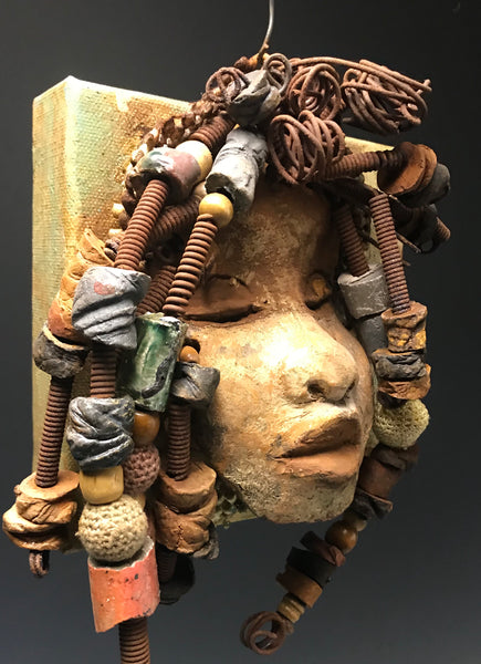 Norway  has over 30 feet of 16 gauge wire for hair and over 35 raku and wooden beads. Norway has an awesome honey brown copper crackle face and lips. Norway   is ready to be hung! Shipping and Returns