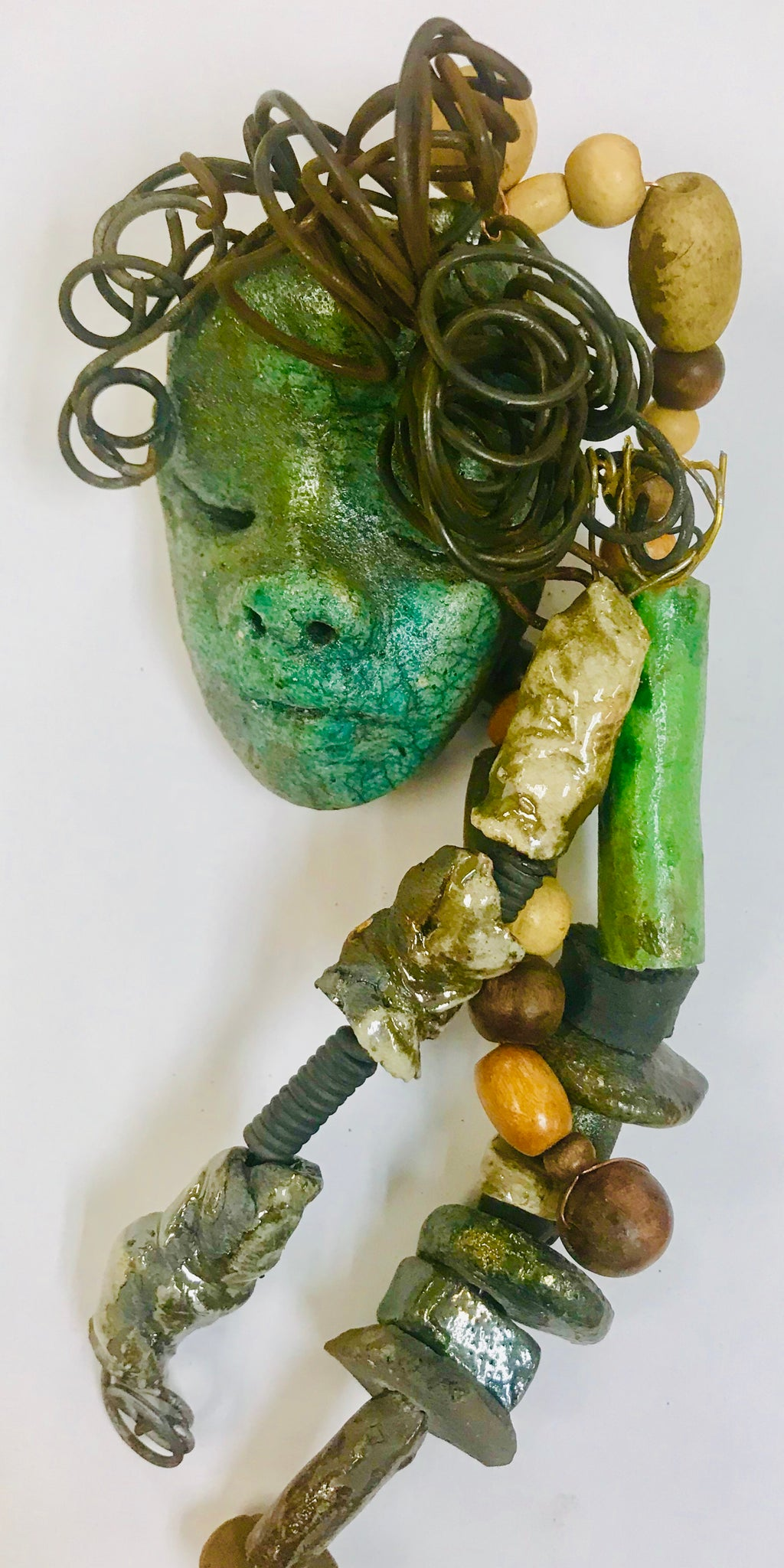 "Meet Paula! Approx. 7""and weighs 7ozs. Olive green  face Over 25 raku and wood beads. This will be a nice mask to add to your collection"