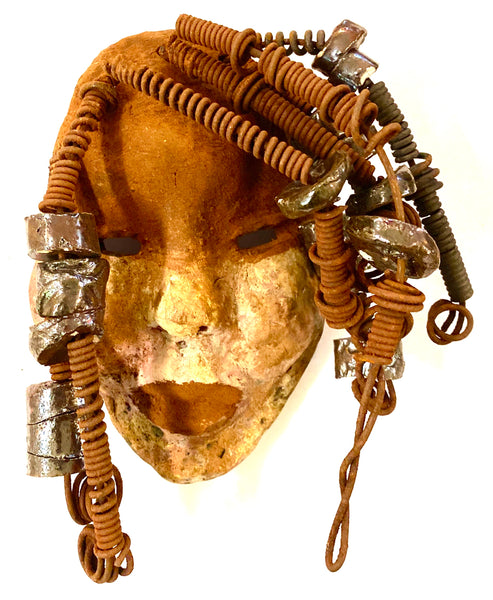 "Macey  has a complexion of light and dark honey. She is 5"" x 7"" and weighs 1.1 lbs. Macey has over 20 handmade raku fired beads. She has over 15 feet of coiled 16 gauge wire hair."