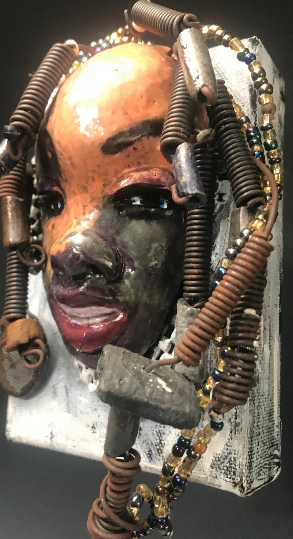 Roberta has over 20 feet of 16 gauge wire for hair and over 40 raku , acrylic, and wooden beads.     Roberta has a light pink and antique copper crackle face and lips.     Roberta  is ready to be hung!