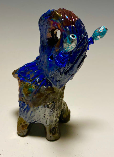 "Raku Elephant Have you HERD!!!!!!  Just one of these lovely Raku Fired Elephant will make an excellent gift for your  friend, sorority or for your home' special place centerpiece.  5"" x 4"" x 4"" 9 ozs. Blue wire beaded blue tusk Beautiful metallic raku colors For decorative purposely only."