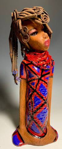 "Meet LaQuisha!  You know someone like LaQuisha. One who reaps elegance and sophistication!  LaQuisha stands 16"" x 6"" x 4"" and weighs 4.5 lbs.  She has a  beautiful honey brown complexion with over 50 feet of 16 gauge spiral coiled wire hair.  LaQuisha's Afrocentric  dress is accented by a ruby red beaded necklace. LaQuisha's  pink eye shadow gives her a distinguished mystical look. Laquisha is ALL dressed Up and wants to be a showcase in your home!"