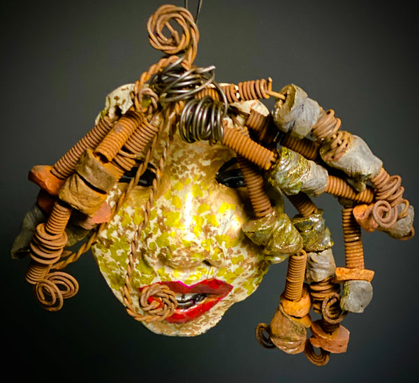 I started making art soon after seeing authentic African artwork at the Smithsonian Museum of African Art. I was in total awe. Bee was inspired by my visit there.  Bee weighs 15 ozs. Her face is formed with hand coiled wire and multiple  raku beads. Bee's face beams with metallic gold and white brown and honey gold and rust reddish brown lips.