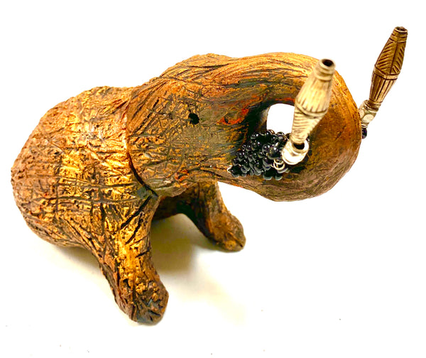 "Have you HERD!!!!!!     Elephants are one of my favorite animals to create. They are so majestic""  Just one of these lovely Raku Fired Elephant will make an excellent gift for your  BFF,  or just for you .    This raku fired elephant stands 5"" x 4"" x 7"" and weighs 1 lb. She has black beaded tusks and a textured and copper metallic body. This one is nice to add your Herdew Collection!"