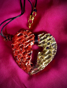"Have A Heart ! Each heart pendant is handmade with love! It is 3""x 3"" and weighs approx. 3ozs. This pendant has a  ruby red and gold metallic raku glazes that renders a unique translucent  patina. The heart  has a textured  pattern with a cut out cross in the center.. It holds a spiral of ruby red mini beads on a spiral copper wire. This pendant has a nice 12"" black suede cord!"