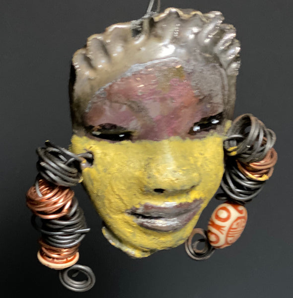 "Meet Lula! I started making art soon after seeing authentic African artwork at the Smithsonian Museum of African Art. I was in total awe. Jafari was inspired by my visit there.   Lula has a two tone complexion of honey mustard and dark metallic copper. She  is 4"" x 6"" and weighs 5 ozs. Lula has 2 tribal beads. Lula has over 15 feet of  coiled copper and 16 gauge wire hair."