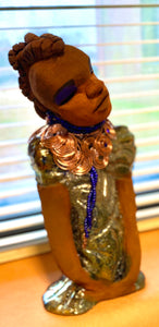 "Georgia stands 11"" x 5"" x 3"" and weighs 2.15 lbs. She has a honey brown complexion with a braided tribal clay hairstyle. She has an awesome copper metallic glitzy dress. Georgia has her long loving arms folded as she rest and waits.  Give  Georgia special place inside of your home."