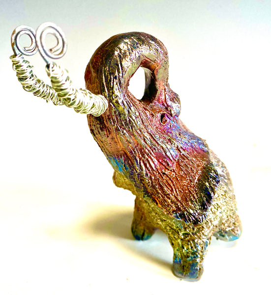 "Raku Elephant Have you HERD!!!!!!  Just one of these lovely Raku Fired Elephant will make an excellent gift for your  friend, sorority or for your home' special place centerpiece.  6"" x 4"" x 5"" 13 ozs. Beautiful copper metallic raku elephant  Spiral silver  tusk For decorative purposely only."