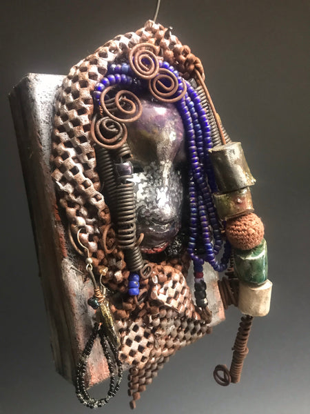 "Carvene is mounted on a 4""x 6"" painted canvas. I spent about 2 hours or more just fixing Carvene's hair and attaching beads!      Carvene  has over 30 feet of 16 gauge wire for hair and over 5 raku beads.     Carvene has a silver and antique copper crackle face and lips.     Carvene  is ready to be hung!  Shipping and Returns"