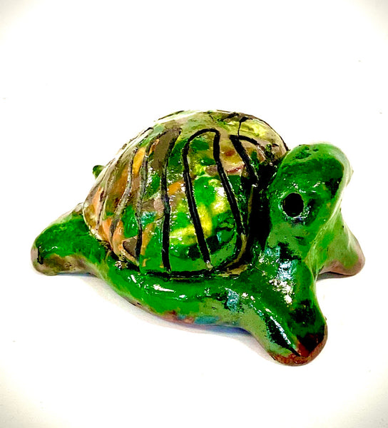 "Boys, girls, men, and women of all ages talked about how cute they are. They got a kick out of and adored the turtles that were named after someone they knew"". Tommie is 2"" x 2"" x 4"" and weighs 5.8 ozs. Tommie has a glossy green and copper complexion. Tommie is ready to Go!!"