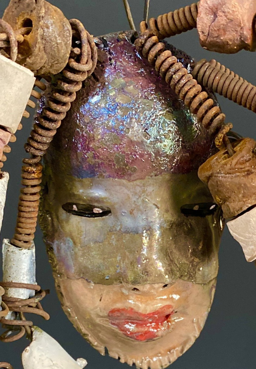 "I started making art soon after seeing authentic African artwork at the Smithsonian Museum of African Art. I was in total awe. Jerri was inspired by my visit there.  Jerri has a two tone copper gold complexion. She is 8"" x 5"" and weighs  11 ozs. Jerri has over 20 handmade raku fired beads. Jerri has over 10 feet of  copper coiled 16 gauge wire hair."