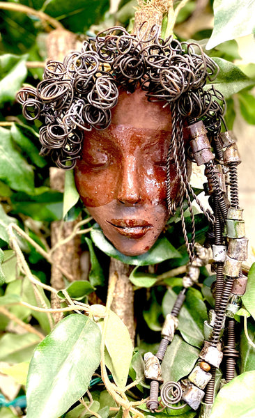 "Coco has a dark brown complexion. She is 12"" x 12"" and weighs 1.6 lbs. Coco has over 30 handmade raku fired beads. She has over 20 feet of coiled 16 gauge wire hair."