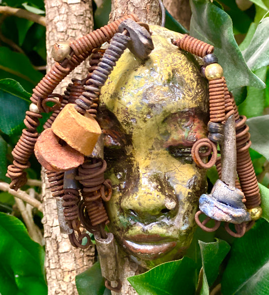 "Araya has a yellow green complexion and dark red lips! She is 3""x 5"""" and weighs 9 ozs. Araya  has over 5 handmade raku fired beads. She has over 20 feet of coiled 16 gauge wire hair."