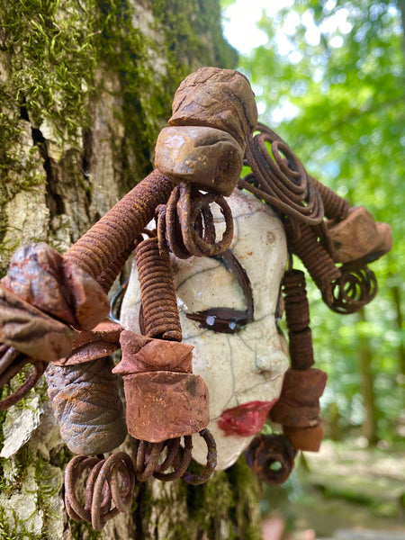"Meet Saracee! I started making art soon after seeing authentic African artwork at the Smithsonian Museum of African Art. I was in total awe. Saracee was inspired by my visit there.   Saracee has a white complexion and ruby red lips! She is 8""x 5"""" and weighs 14 ozs. Saracee has over 10 handmade raku fired beads. She has over 10 feet of coiled 16 gauge wire hair."