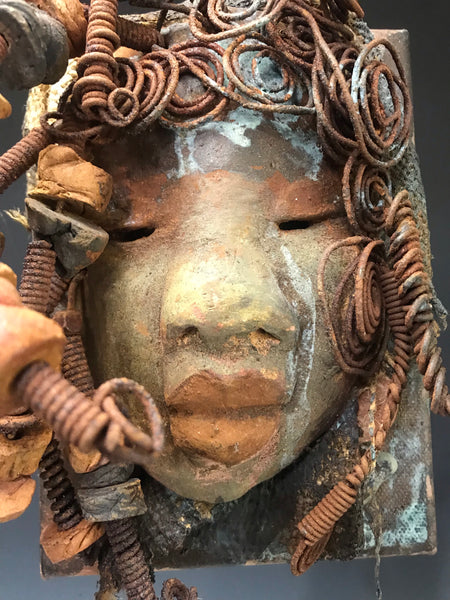 Rocco  has over 20 feet of 16 gauge wire for hair and over 20 raku and wooden beads. Rocco  has an awesome earthyhoney brown blue copper crackle face and lips. Rocco is ready to be hung!