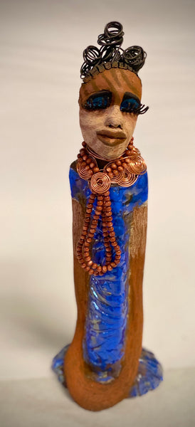 "Meet Jamayah!  You know someone like Jamayah. One who reaps elegance and sophistication!  Jamayah stands 18"" x 6"" x 5"" and weighs 3.13 lbs.  She has a light beige tribal scarification with over 5 feet of 16 gauge spiral coiled wire hair.  Jamayah's metallic copper turquoise dress is accented by a multicolored  earthy beaded necklace. Jamayah's  black eye shadow and long lashes give her a distinguished mystical look."