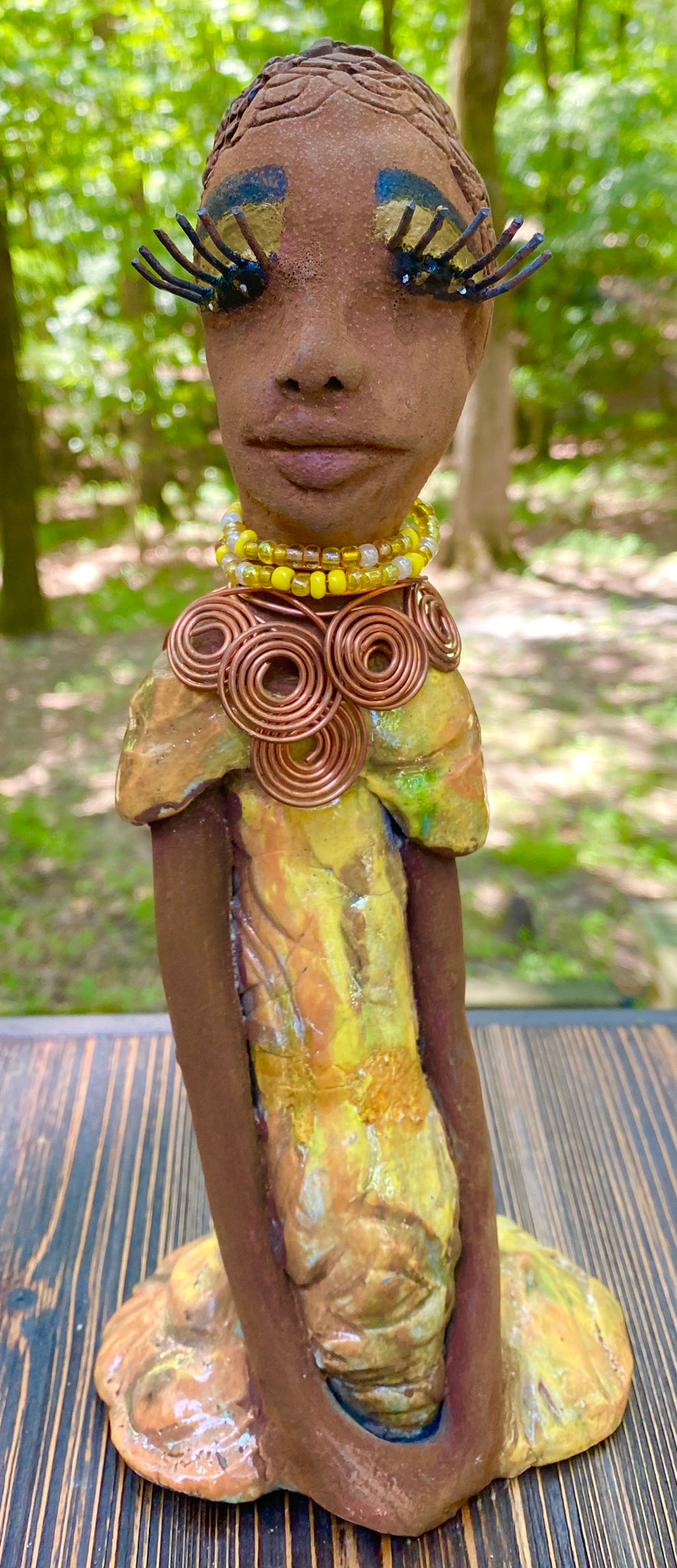 "Meet Clarice! What a joy to be around a teen like Clarice! She is one of many who has a polite gentle spirit! Clarice stands 11"" x 5"" x 3"" and weighs 1.1 lbs. Clarice has a lovely honey brown complexion. Her  hair is made of textured clay. She has a  textured  colorful copper metallic dress. Clarice is a young man full of pride and joy. If you like sophisticated  sculptures, Clarice will bring joy and peace to your home."