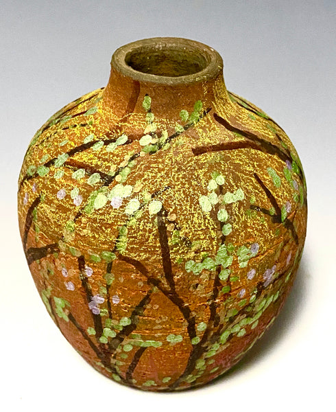 "This little 5"" x 4"" x 4"" pot is hand painted and raku fired. It has an earthy  honey, yellow, and brown matte patina depicting a landscape.  This vase is made for decorative purposes only."