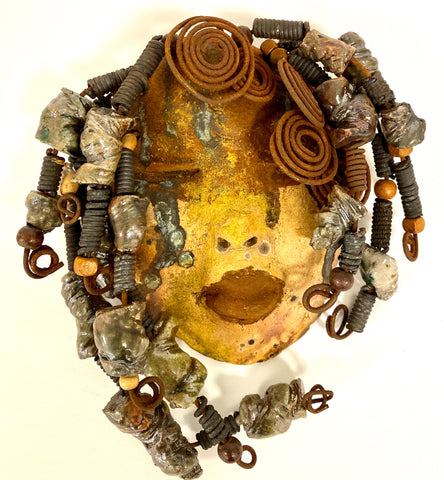 "Bianca has a complexion of light and dark honey. She is 5"" x 7"" and weighs 1.3 lbs. Bianca has over 40 handmade raku fired beads. She has over 20 feet of coiled 16 gauge wire hair."