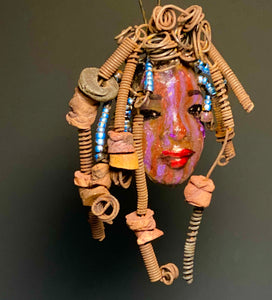 "I started making art soon after seeing authentic African artwork at the Smithsonian Museum of African Art. I was in total awe. Melanie was inspired by my visit there.  Melanie has deep purple stripe complexion. She is 7"" x 5"" and weighs  9 ozs. Melanie has 10 handmade raku fired beads. Melanie has over 20 feet of  copper coiled 16 gauge wire hair."