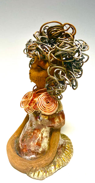 "Meet Amy! Amy stands 7"" x 4"" x 5"" and weighs 1.5 ozs. Amy has a honey brown complexion with 16 gauge curled wire hair. She wears an copper metallic dress. Amy wears an awesome copper spiral copper necklace. Amy  has her long loving arms at her side as she rest and waits.  With the current situation we All are going through, Amy will place a smile on your face during this challenging time. With a reduced price! Give Amy a special place in of your home today."