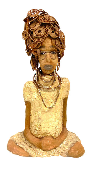 "Checkout Dewana look. What possibly could she be thinking? Dewana stands 16"" x 9"" x 7""and weighs 5.15 lbs. Alice wears a metallic textured chestnut brown dress with matching amber beads."