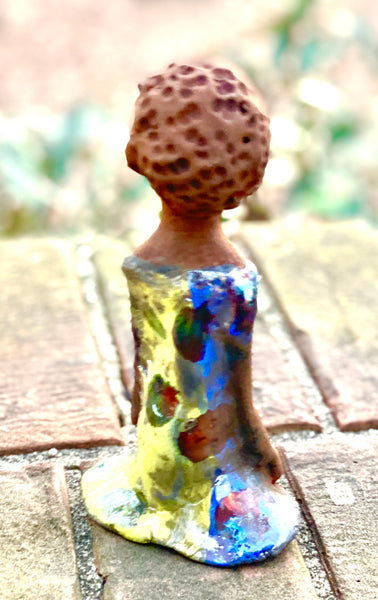 "Adisa stands 7' x 4""x 2"" and weighs 10.3 ozs. She has bright  dark eyes and a nice honey two tone brown complexion Her long trademark arms rest at her side. Adisa dress is a loving glossy blue and yellow mix with copper flashes."