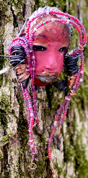 "Meet Calandra! I started making art soon after seeing authentic African artwork at the Smithsonian Museum of African Art. I was in total awe. Calandra was inspired by my visit there.   Calandra has a two tone red and dark metallic copper complexion. She  is 6"" x 4"" and weighs 6.5 ozs. Calandra has over 4 feet of coiled 16 gauge wire hair and countless red mini beads.."