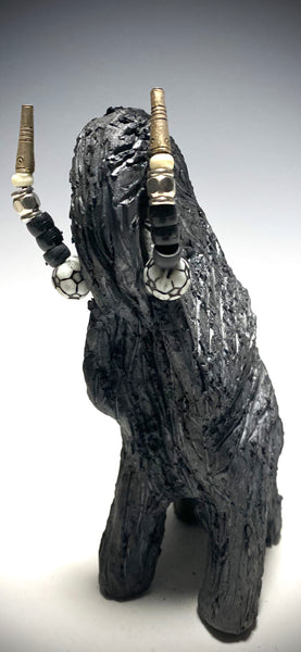 """Elephants are one of my favorite animals to create. They are so majestic"" This raku fired elephant stands 7"" x 2"" x 2.5"" and weighs 10 ounces. She has beaded tusks and a textured smokey black body. Nice! Great for a gift!"