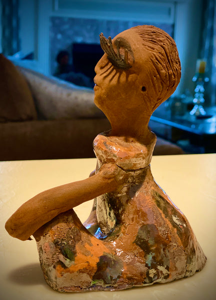 "Yasmine stands 7"" x 6"" x 5"" and weighs 1.6 lbs.  Yasmine has a honey brown complexion with clay hair. She wears long lashes and has a copper metallic dress.  Yasmine has her long loving arms folded as she rest and waits."