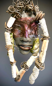 "Meet Adisa! I started making mask after seeing an authentic African Mask collection at the Smithsonian Museum of African Art. I was in total awe. Adisa was inspired by my visit there.   Adisa has a two tone complexion of black and dark metallic copper. She  is 8"" x 6"" and weighs 13 ozs. Adisa has over 10 handmade raku fired beads. She has over 10 feet of coiled 16 gauge wire hair."