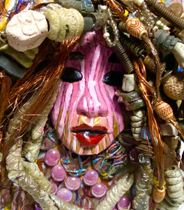 "Sabra is mounted on a 8""x 10""painted canvas. I spent about 4 hours or more just fixing April's hair and attaching her beads! She has over 60 feet of 16 gauge wire  with multiple strands of copper wire for hair and over 50 raku beads. Sabra has a striped pink crackle face with and ruby red lips. She is ready to be hung!"