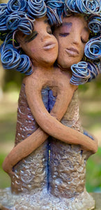 "Sister Love is a raku fired sculpture. Raku is a specialized firing technique that involves high heat and open flames. Sister Love stands 11"" x 5"" x 3"" and weighs 2.06 lbs. Combined they have over 45 feet of curled 16 gauge wire hair. The dresses are textured with an antique copper glaze. They have lovely honey brown complexions and long loving arms. Sister Love is inseparable! Give them a special place in your home. Free Shipping!"