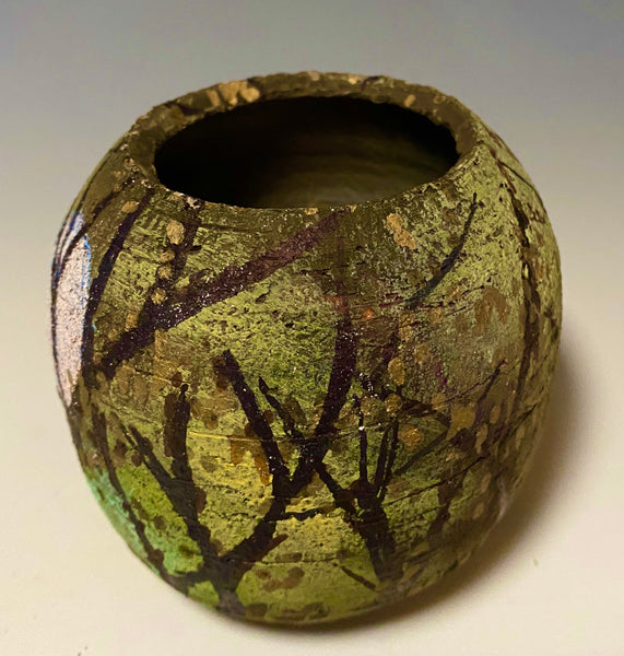 "This little 3"" x 4"" x 4"" pot is hand painted and raku fired. It has an earthy  honey, yellow, and brown matte patina depicting a landscape with a full moon glow! This little vase is made for decorative purposes only."