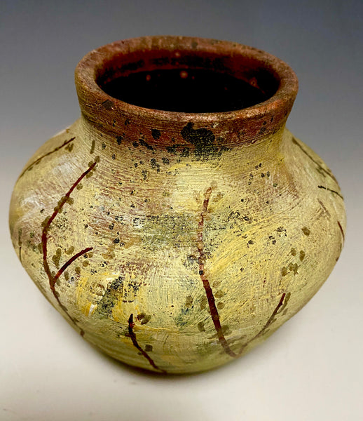 "This little 5"" x 4"" x 4"" vase is hand painted and raku fired. It has an earthy  honey, yellow, and brown matte patina depicting a landscape with a moon glow! This little vase is for decorative purposes only."