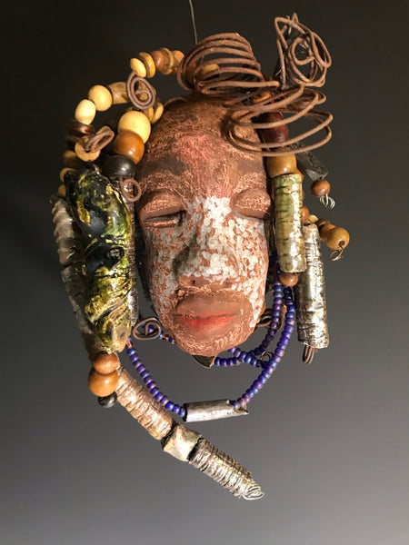 "Brodie has a complexion of light silver and dark honey.     He  is 5"" x 7"" and weighs 13 ozs.     Brodie has over 20 handmade raku fired and wood beads.     He has over 25 feet of coiled 16 gauge wire hair.   Brodie reminds me of Amanda. Check Amanda out as well. Shipping and Returns"