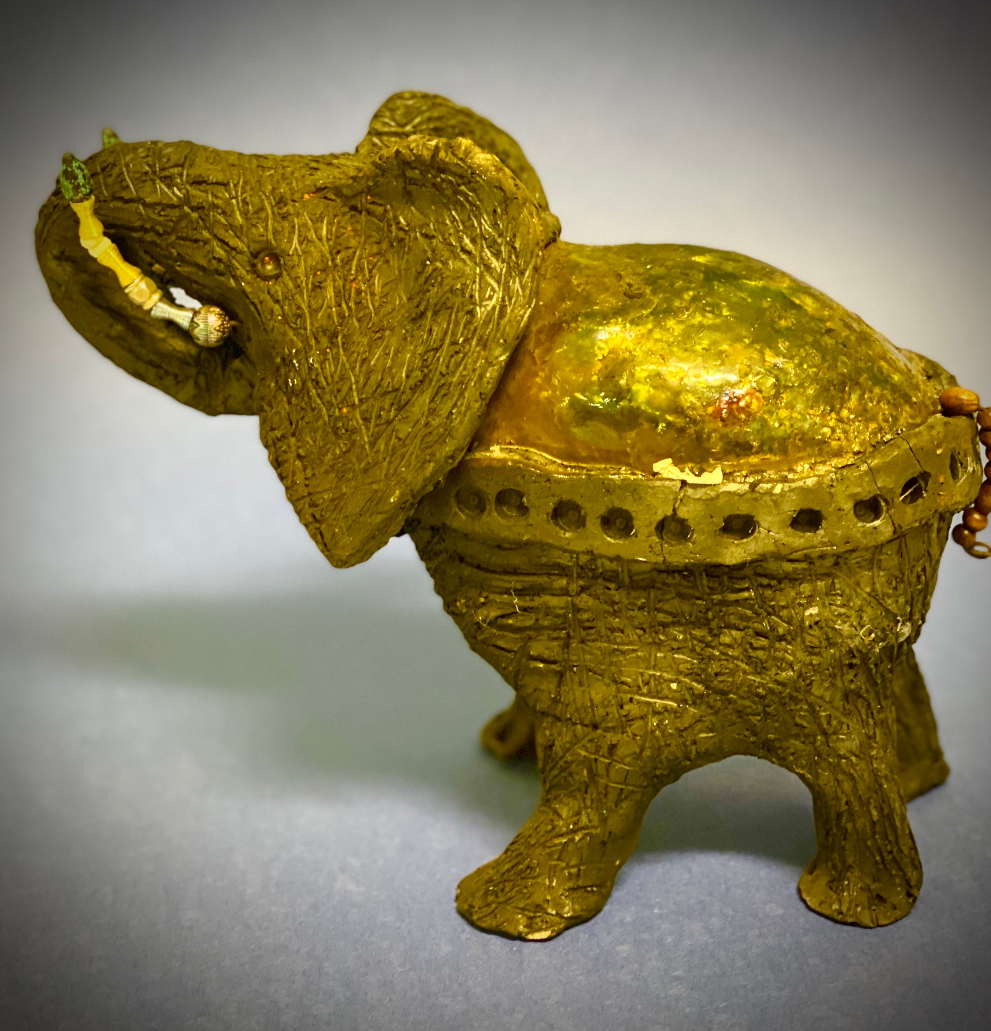 "Just one of these lovely Raku Fired Elephant will make an excellent gift for you, your friend, sorority or for the home.    This majestic animal stands 8"" x 5"" x 5"" and weighs 3.7 lbs  Use for decorative purposely only."