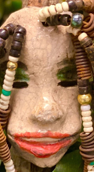 "Nema has an off white  complexion. She is 4"" x 3"" and weighs 8ozs. Nema has over 40 mixed beads. She has over 20 feet of coiled 16 gauge wire hair."