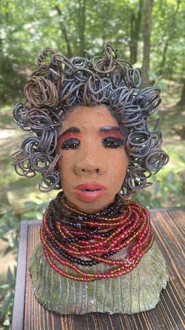 "Meet Joyce! Joyce stands 8.5 x 5"" x 5.5"" and weights 1.3 lbs She has a lovely cinnamon complexion Joyce dress is iridescent green with hints of copper. Joyce's 20 feet wire hair is coiled, curled, and twisted with dangles. Give Joyce a warm welcome to your home!"