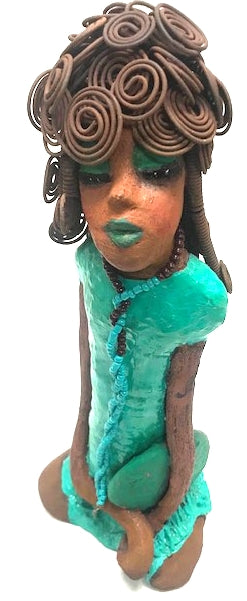 "Meet Imogene She's a Queen! You know a Imogene. She's dressed up and looking like she has somewhere to go! Imogene stands 13"" x 6"" x 4"" and weighs 2.9 lbs. Checkout her outstanding green makeup on her honey brown complexion. 2 hours fixing 20 feet of wire on her hairdo- Herdew.  Necklace with strand of turquoise colored bead.  Big round purse.  Look like Imogene is Looking for a Throne Free Shipping!"